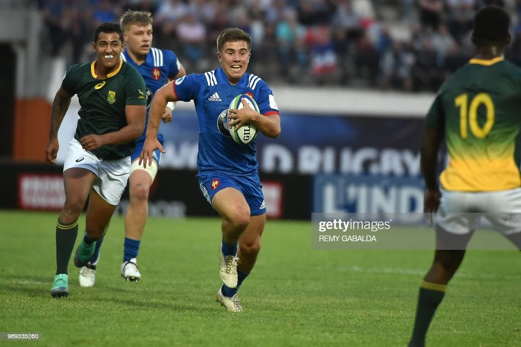 France's Louis Carbonel runs with the ball during the Rugby Union World Cup U20 championship match between South Africa and France at the Parc des Sports Stadium in Narbonne, southern France, on June 7, 2018.