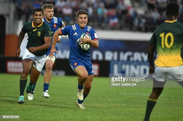 France's Louis Carbonel runs with the ball during the Rugby Union World Cup U20 championship match between South Africa and France at the Parc des...