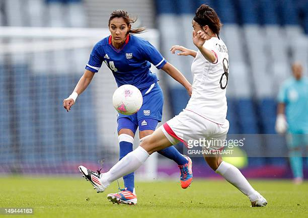 France's Louisa Necib vies for the ba with North Korea's Jon Myong Hwa during the London 2012 Olympic Games women's football match at Hampden Park...