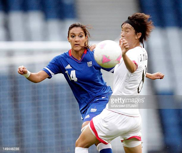 France's Louisa Necib vies for the ball with North Korea's Jon Myong Hwa during their London 2012 Olympic Games women's football match at Hampden...