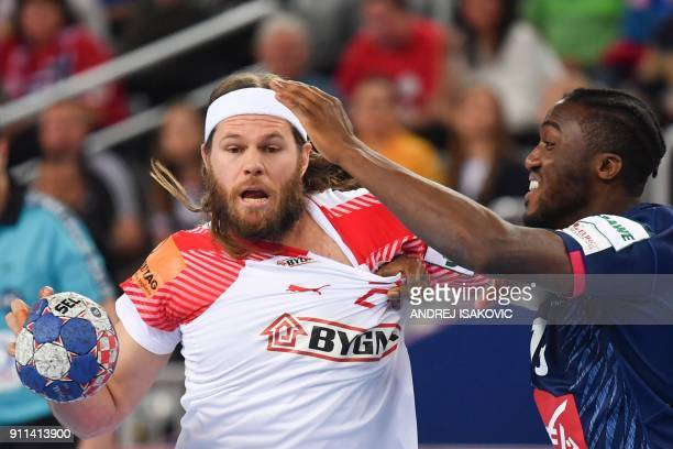 France's Luc Abalo defends against Denmark's Mikkel Hansen during the match for third place of the Men's 2018 EHF European Handball Championship...
