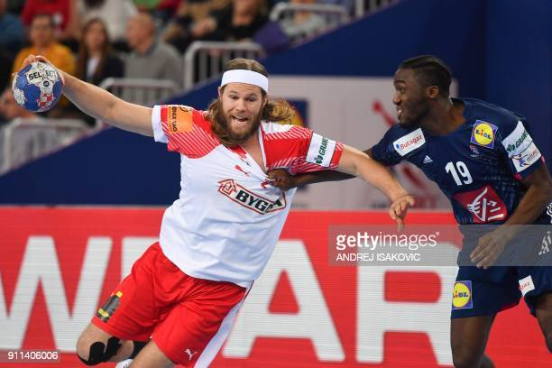 France's Luc Abalo holds off Denmark's Mikkel Hansen during the match for third place of the Men's 2018 EHF European Handball Championship between...