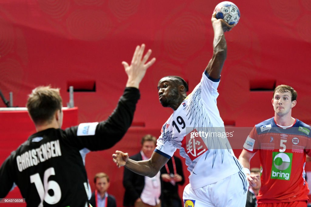France's Luc Abalo (R) shoots on goal during the preliminary round group B match of the Men's 2018 EHF European Handball Championship between France and Norway in Porec, Croatia on January 12, 2018. /