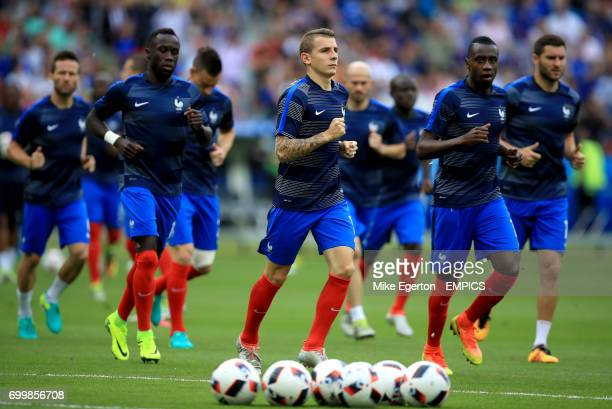 France's Lucas Digne and his team-mate warming up before the game.