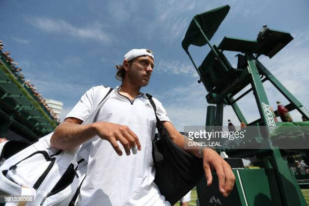 France's Lucas Pouille arrives on court to play Austria's Dennis Novak during their men's singles second round match on the third day of the 2018...