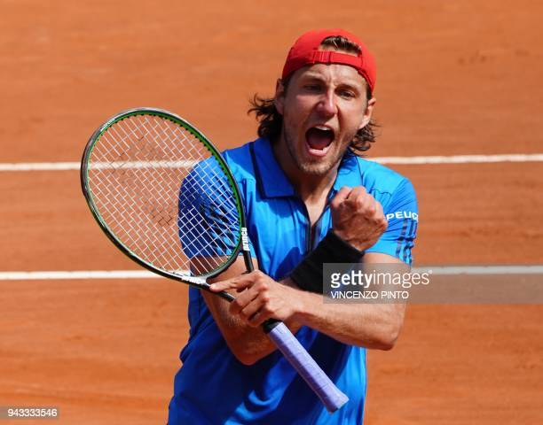 France's Lucas Pouille celebrates after winning against Italy's Fabio Fognini during the Davis Cup quarter final Italy vs France on April 8 2018 at...