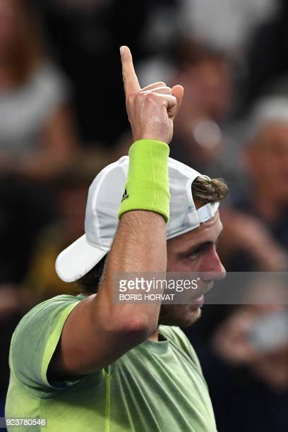 France's Lucas Pouille celebrates his victory against Belarus' Ilyia Ivashka after their singles semi final match of the ATP Marseille Open 13...