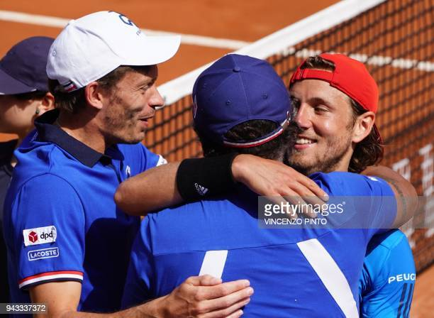 France's Lucas Pouille celebrates with coach Yannick Noah and teammate Nicolas Mahut after winning the Davis Cup quarter final Italy vs France...