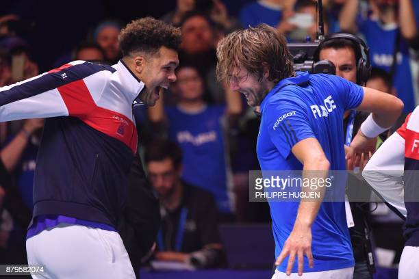 TOPSHOT France's Lucas Pouille celebrates with France's JoWilfried Tsonga after winning his singles rubber 5 match against Belgium's Steve Darcis at...