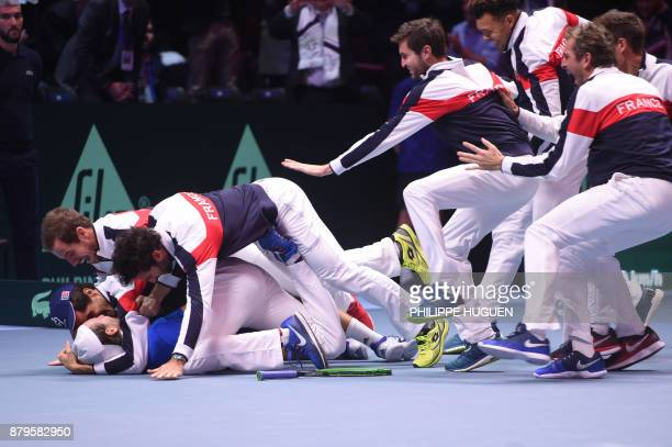 TOPSHOT France's Lucas Pouille celebrates with his teammates after winning his singles rubber 5 match against Belgium's Steve Darcis at the Davis Cup...