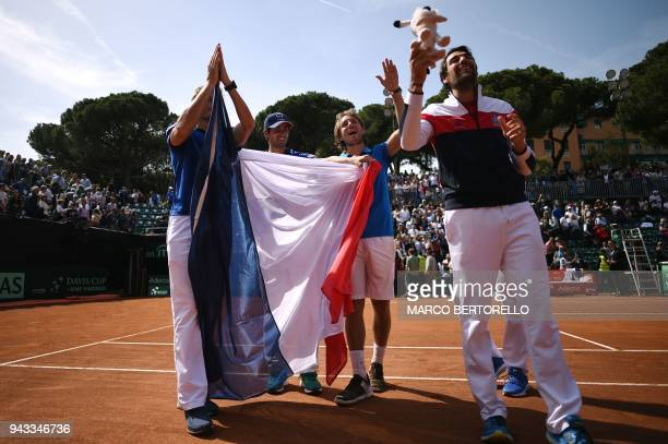 France's Lucas Pouille celebrates with teammates Jeremy Chardy Nicolas Mahut and PierreHugues Herbert after winning the Davis Cup quarter final Italy...
