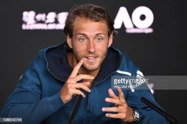 TOPSHOT France's Lucas Pouille gestures during a press conference after he lost to Serbia's Novak Djokovic in their men's singles semifinal match on...