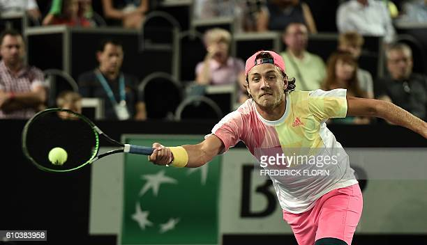 France's Lucas Pouille hits a return to Austria's Dominic Thiem during the ATP Moselle Open final tennis match on September 25 2016 in Metz eastern...