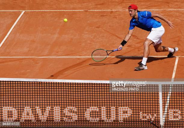 TOPSHOT France's Lucas Pouille hits a return to Italy's Fabio Fognini during the Davis Cup quarter final Italy vs France on April 8 2018 at the...