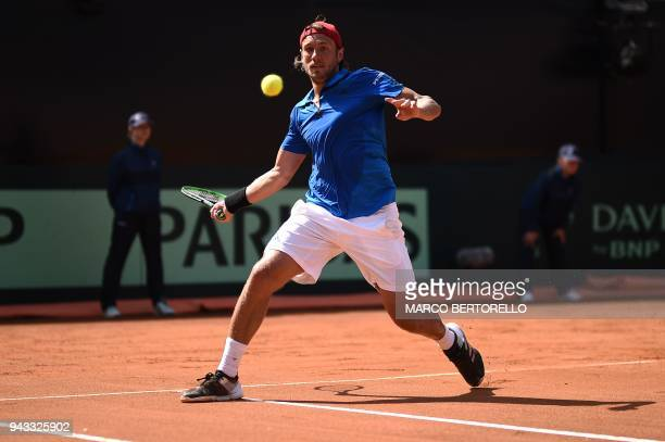 France's Lucas Pouille hits a return to Italy's Fabio Fognini during the Davis Cup quarter final Italy vs France on April 8 2018 at the 'Valletta...