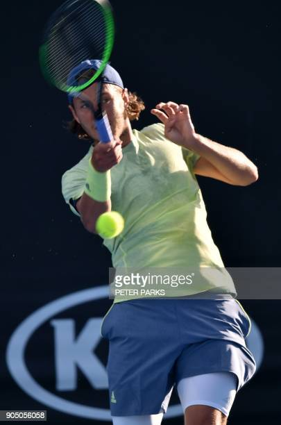 France's Lucas Pouille plays a forehand return to Belgium's Ruben Bemelmans during their men's singles first round match on day one of the Australian...