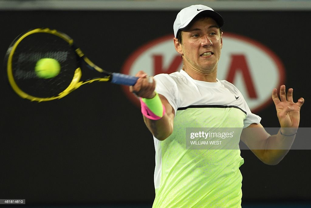 France's Lucas Pouille plays a shot during his men's singles match against compatriot Gael Monfils on day two of the 2015 Australian Open tennis tournament in Melbourne on January 20, 2015.
