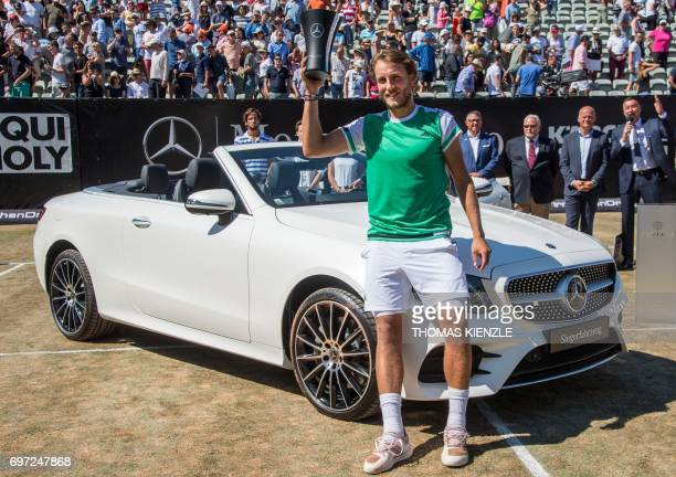 France's Lucas Pouille poses next to the winner's car a MercedesBenz E 400 Cabrio 4 Matic after defeating Spain's Feliciano Lopez in the final match...