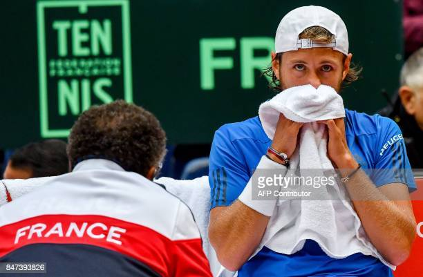 France's Lucas Pouille reacts after loosing a point against Serbia's Dusan Lajovic during their singles rubber for the Davis Cup World Group...