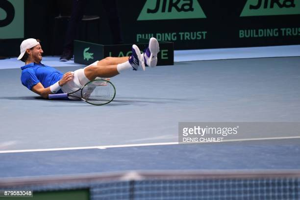 France's Lucas Pouille reacts after winning his singles rubber 5 match against Belgium's Steve Darcis at the Davis Cup World Group final tennis match...