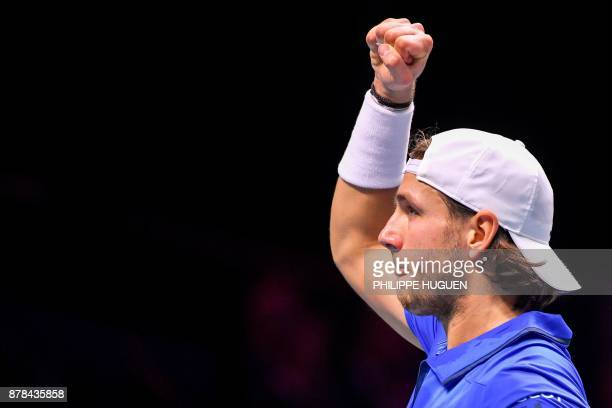 France's Lucas Pouille reacts during a Davis Cup World Group singles rubber final tennis match between France and Belgium against Belgium's David...