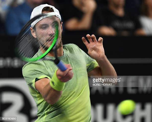 France's Lucas Pouille returns a ball to Belarus' Ilyia Ivashka during their singles semi final match of the ATP Marseille Open 13 Provence tennis...