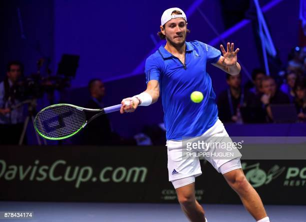 France's Lucas Pouille returns the ball to Belgium's David Goffin during their Davis Cup World Group singles rubber final tennis match between France...