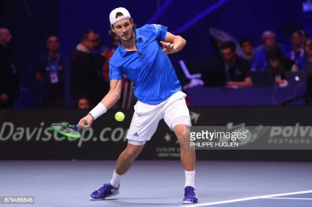 France's Lucas Pouille returns the ball to Belgium's Steve Darcis during their singles rubber 5 of the Davis Cup World Group final tennis match...
