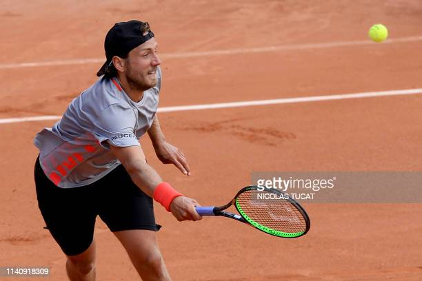 France's Lucas Pouille returns the ball to France's Quentin Halys during the men's singles quarterfinal match on the fourth day of the ATP Challenger...