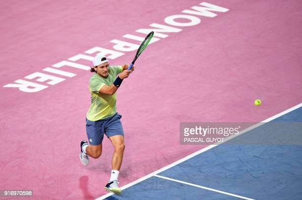 France's Lucas Pouille returns the ball to France's Richard Gasquet during their the ATP World Tour Open Sud de France final tennis match in...