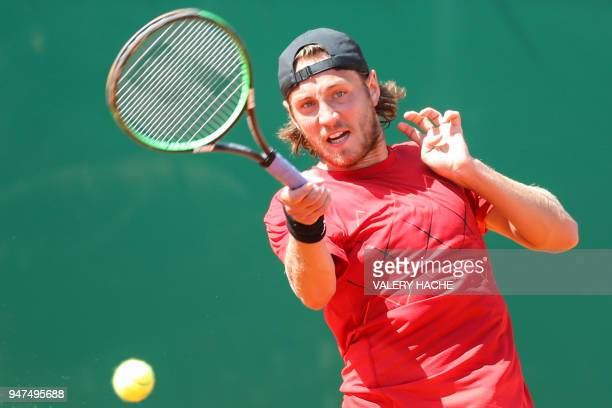 France's Lucas Pouille returns the ball to Germany's Mischa Zverev during their tennis match as part of the Monte-Carlo ATP Masters Series...