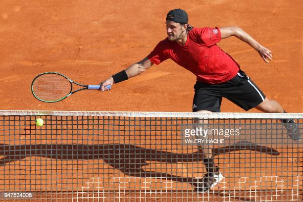 France's Lucas Pouille returns the ball to Germany's Mischa Zverev during their tennis match as part of the MonteCarlo ATP Masters Series Tournament...