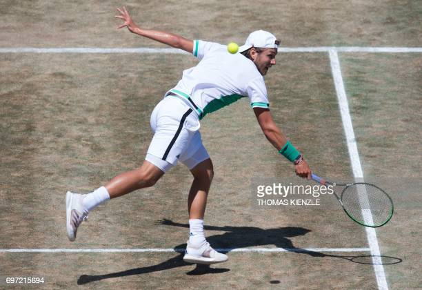 France's Lucas Pouille returns the ball to Spain's Feliciano Lopez in the final match at the ATP Mercedes Cup tennis tournament in Stuttgart,...