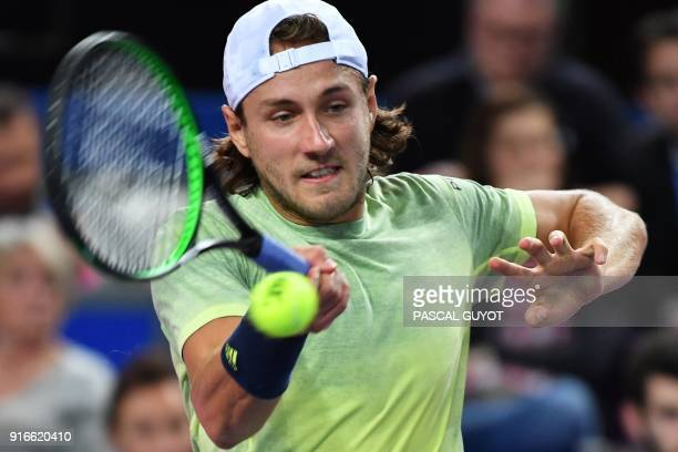 France's Lucas Pouille returns to JoWilfried Tsonga during their semi final tennis match at the Open Sud de France ATP World Tour in Montpellier...