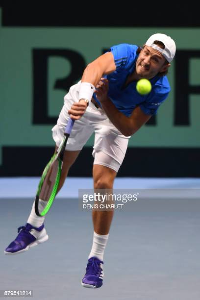 France's Lucas Pouille serves the ball to Belgium's Steve Darcis during their singles rubber 5 of the Davis Cup World Group final tennis match...