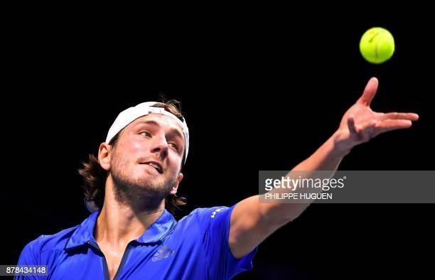 France's Lucas Pouille serves to Belgium's David Goffin during their Davis Cup World Group singles rubber final tennis match between France and...