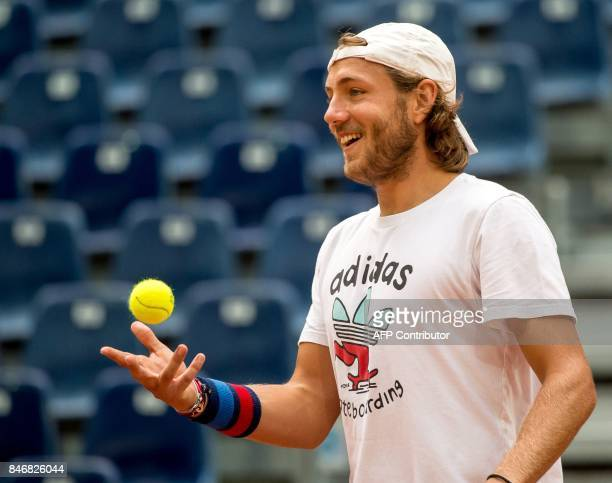 France's Lucas Pouille takes part in a training session of the French team ahead of the Davis Cup World Group semi-final between France and Serbia,...