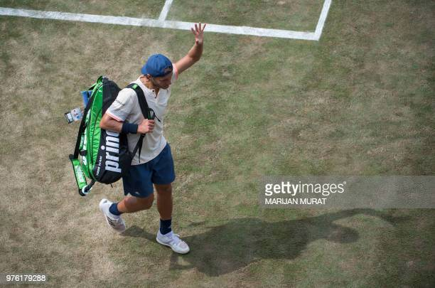 France's Lucas Pouille waves as he leaves the central court after losing his semifinal match against Canada's Milos Raonicat the ATP Mercedes Cup...