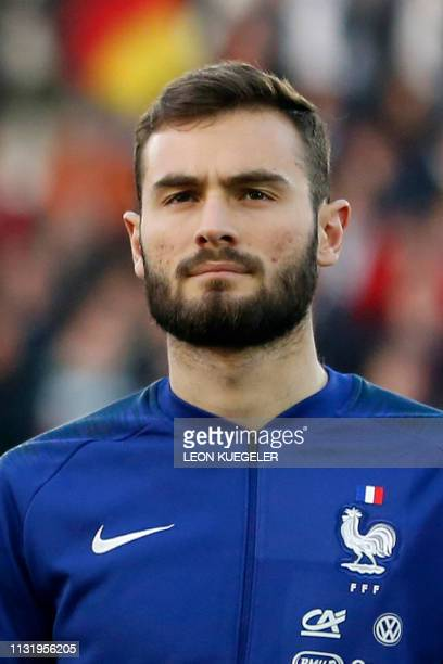 France's Lucas Tousart listens to the national anthem before the friendly under21 football match between Germany and France in Essen western Germany...