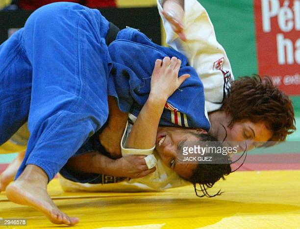 France's Lucie Decosse struggles with Great Britain's Sarah Clarks before winning in the 63 kg category final 08 February 2004 at the 30th Paris...