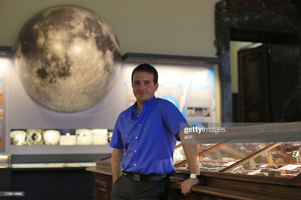 France's Ludovic Ferriere, Co-Curator of the meteorite collection of the Natural History Museum (Naturhistorisches Museum Wien NHM) poses at the Meteorite room of the NHM in Vienna on June 18, 2013. An approx. 84 grams (2.96 Oz) basalt stone is displayed at the museum and was brought during the 'Apollo 15' mission in 1971.