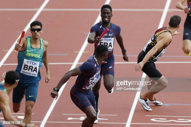 France's Ludvy Vaillant hands over the baton to Thomas Jordier in the men's 4x400m relay athletics event at the 2017 IAAF World Championships at the...