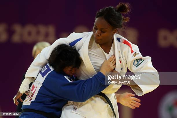 France's Madeleine Malonga and Japan's Shori Hamada fight in the final of women's under 78kg category during the World Judo Masters in the Qatari...