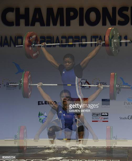 France's Madeleine Yamechi competes to finish fifth in women 69 kg category during 2008 european weightlifting championships in Lignano Sabbiadoro on...