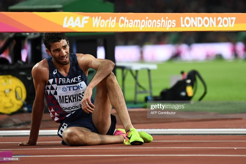 TOPSHOT - France's Mahiedine Mekhissi reacts after the final of the men's 3,000m steeplechase athletics event at the 2017 IAAF World Championships at the London Stadium in London on August 8, 2017. / AFP PHOTO / Jewel SAMAD