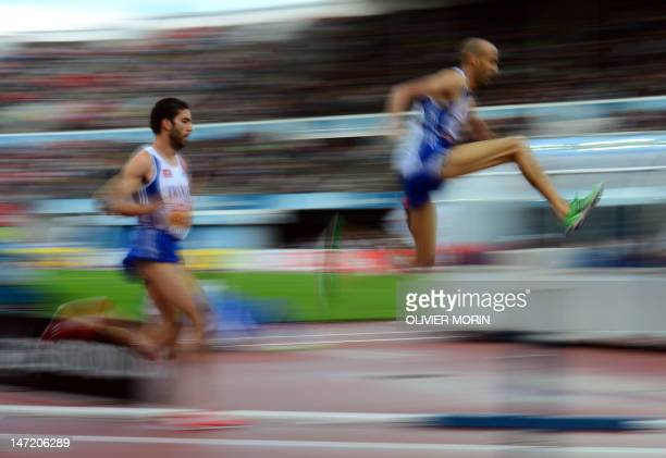 France's Mahiedine Mekhissi-Benabbad and France's Nordine Gezzar compete during the men's 3000m steeplechase semifinals of the 2012 European...