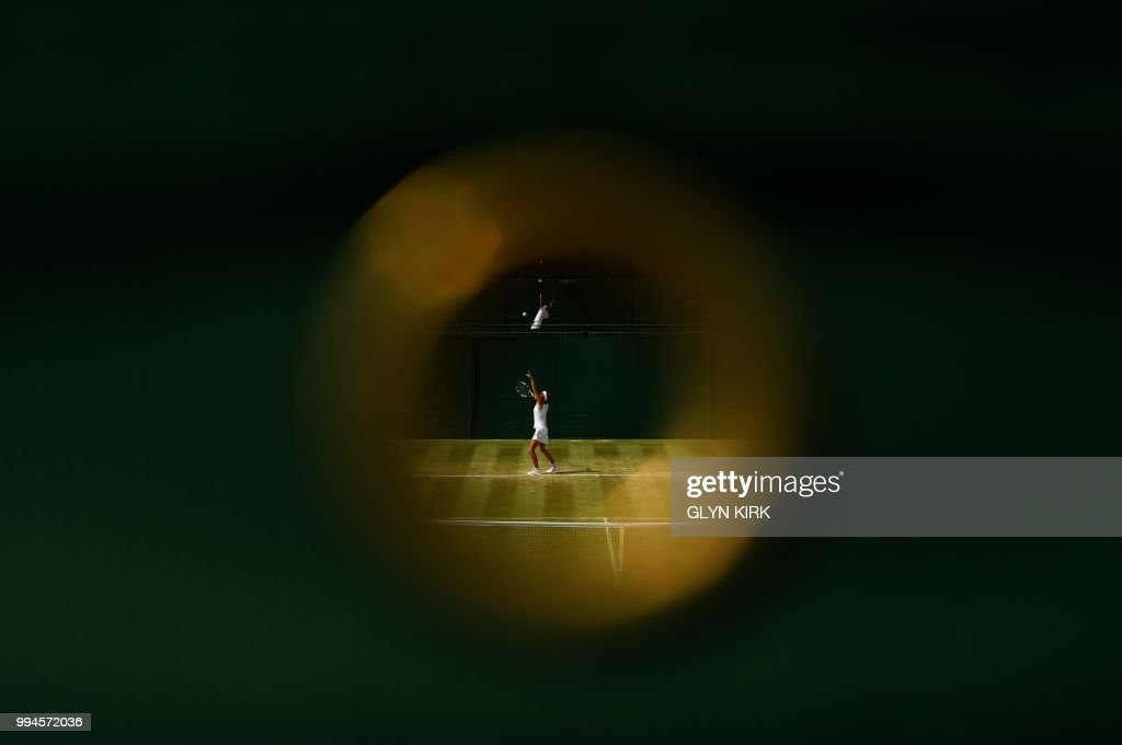 TOPSHOT - France's Manon Leonard throws the ball to serve during her girl's singles first round match on the seventh day of the 2018 Wimbledon Championships at The All England Lawn Tennis Club in Wimbledon, southwest London, on July 9, 2018. (Photo by Glyn KIRK / AFP) / RESTRICTED