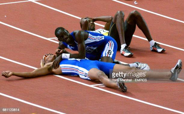 France's Marc Raquil is congratulated on his bronze medal by teammate Leslie Djhone as Jamaica's Michael Blackwood looks on