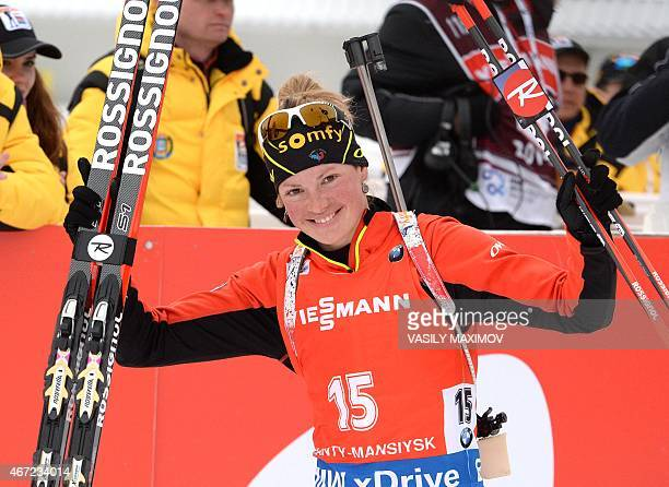 France's Marie Dorin Habert celebrates her third place as she arrives for the podium ceremony of the women's 125 km mass start event of the Biathlon...
