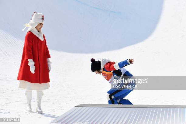 TOPSHOT France's Marie Martinod celebrates on the podium during the victory ceremony after the women's ski halfpipe final during the Pyeongchang 2018...